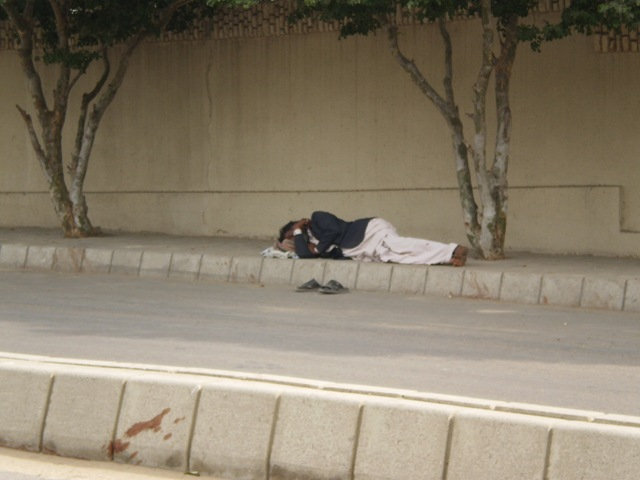 Dec-05-06-2009 -man sleeping on roadside
